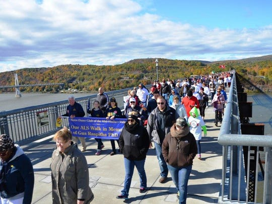 Walkers take part in the ALS walk on the Walkway Over the Hudson on Oct. 14, 2014.  More than 2,200 walkers turned out, making the walk the largest ever held on Walkway Over the Hudson State Park.