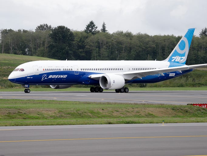 Boeing's 787-9 Dreamliner taxis before taking off on its maiden flight on Sept. 17, 2013, at Paine Field in Everett, Wash. The 787-9 is 20 feet longer and can seat 40 more passengers than the 787-8. The new version of the Dreamliner can also carry more cargo and fly farther.