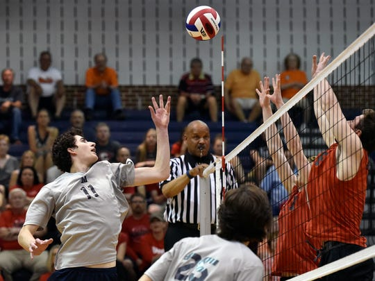 Penn Manor's Sam Greenslade tips the ball against Hempfield in the fourth game of the PIAA District 3 Class AAA boys' volleyball title match Friday, May 27, 2016, at Dallastown. Penn Manor won 3-1 (20-25, 25-15, 25-22, 25-18) to win the district championship over Hempfield.