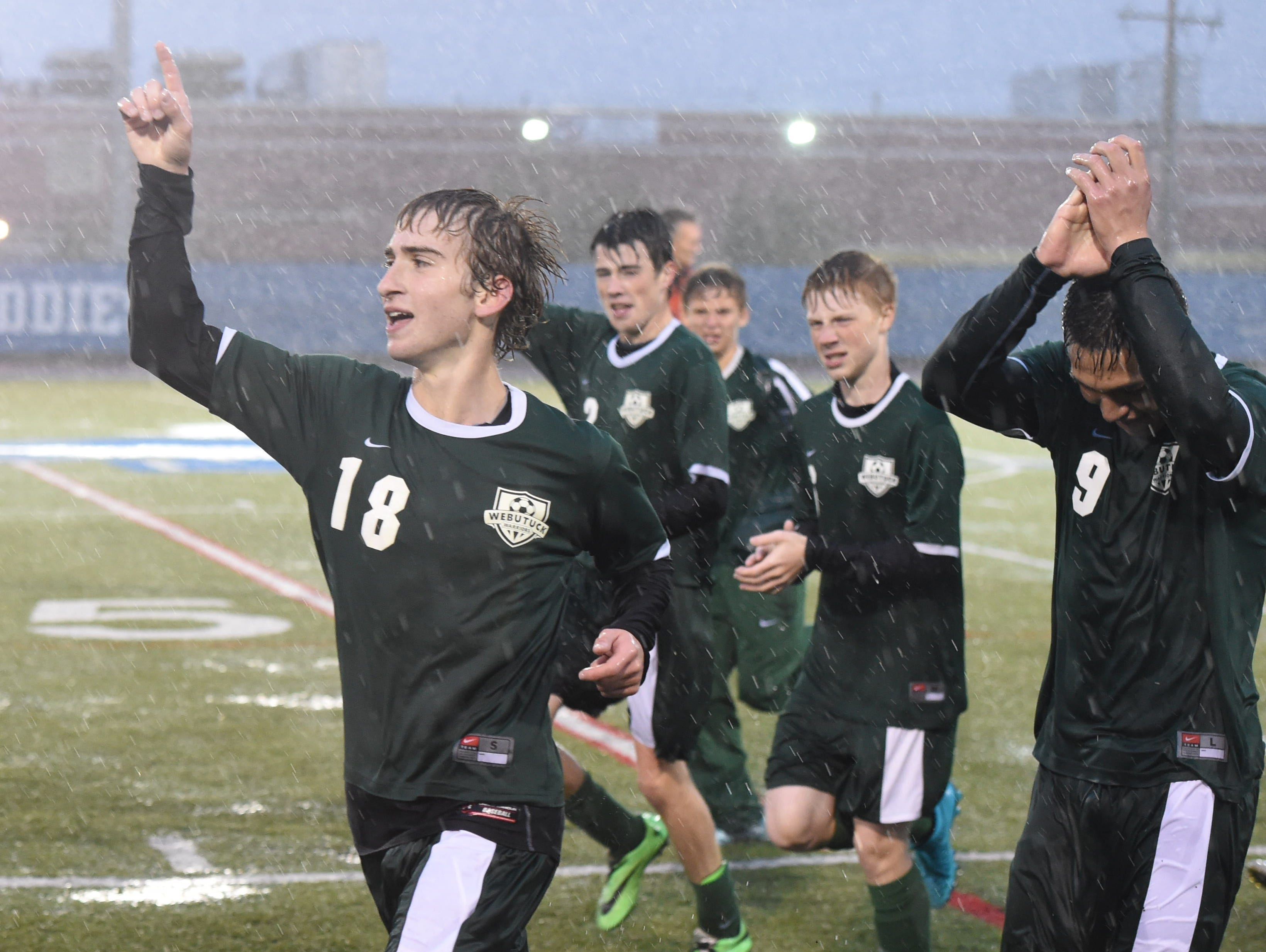 Webutuck's Chris Miloneo leads his teammates in celebrating their win over Millbrook for the Section 9 Class C boys soccer championship in October 2015.