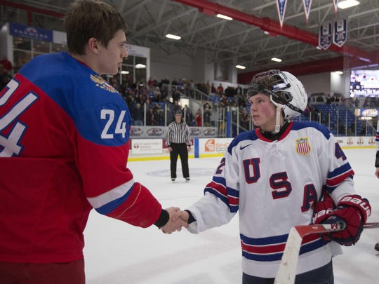 Sean Dhooghe shakes hands with an opponent while playing with the U.S. National Team Development Program in 2017.