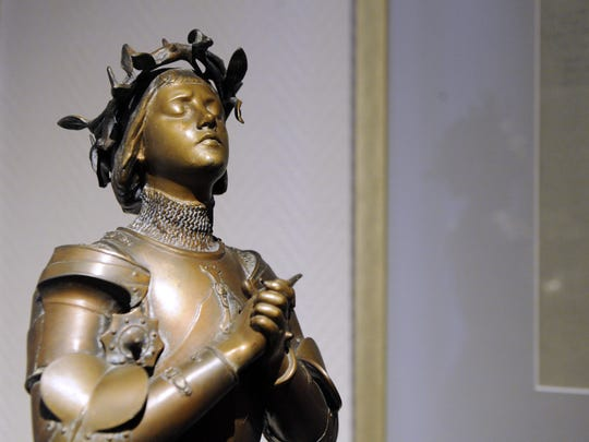 A picture taken on January 6, 2012 shows a bronze statue of Joan of Arc designed by Antonin Merci, in the Jehanne d'Arc museum in the French northeastern city of Vaucouleurs. Joan of Arc passed through Vaucouleurs in 1429 on her way to the French royal court to lobby the monarch to join the fight against the English and the Burgundians during the Hundred Years War.