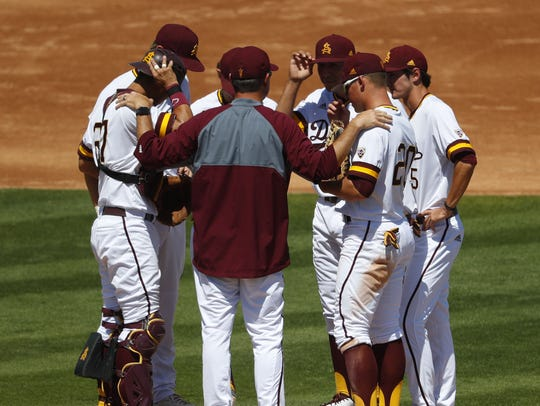 ASU's pitching coach Mike Cather comes out for a visit