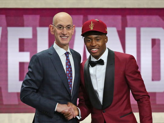 Alabama's Collin Sexton, right, poses with NBA Commissioner Adam Silver after he was picked eighth overall by the Cleveland Cavaliers during the first round of the NBA basketball draft in New York, Thursday, June 21, 2018. (AP Photo/Kevin Hagen)