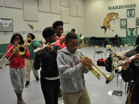 Students practice marching and playing Thursday during the Bontempian Big Band's final rehearsal of the week.