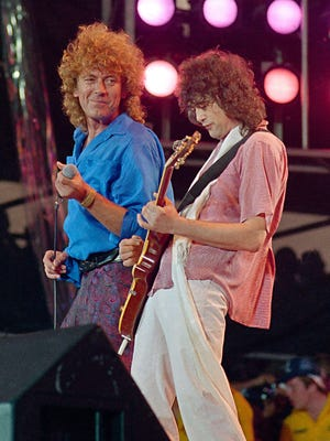 Led Zeppelin bandmates Robert Plant, left, and Jimmy Page reunited to perform at Live Aid in Philadelphia on July 13, 1985.