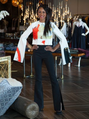 Model Mikayla wears the Pruet Top ($447) and Grace Trousers ($405) by Solace London. All gold jewelry by Aurélie Bidermann, $450-$780. Stylist: Star Hawks
