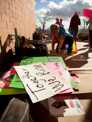 St. George residents march in solidarity with women around the country to stand up for women's rights Saturday, Jan. 21, 2017.