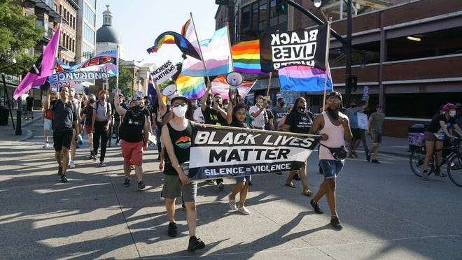 "Marchers in support of queer and transgender people of color, organized by Rhode Island Pride, head up Weybosset Street from Cathedral Square to the State House. Saturday's event was billed as a ""Resistance and Resilience Rally: Trans Black Lives Matter."""