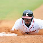 William Carey University player Jordan Anderson (16) dives to first base during a game against Belhaven Friday.