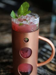 A non-alcoholic raspberry mojito from M Cantina in