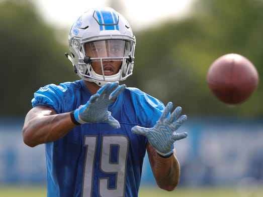 Lions receiver Kenny Golladay catches balls from a