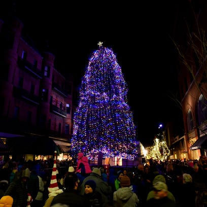 Let there be light! Christmas tree glows from top block of the Church Street Marketplace