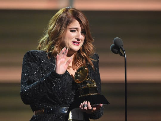 """""""I'm a mess, I have to go cry!"""" Meghan Trainor tearfully accepts the award for best new artist at the Grammys in February."""
