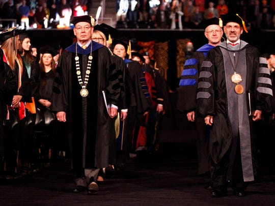 President Joe DiPietro, right, and Chancellor Jimmy Cheek lead the faculty procession during the 2013 Winter Commencement ceremony Friday, Dec. 13, 2013, at the University of Tennessee.