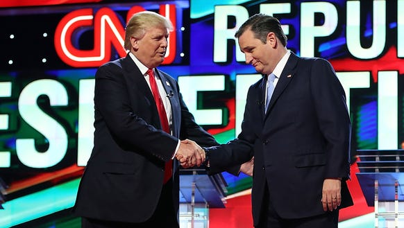 Donald Trump and Ted Cruz shake hands prior to the