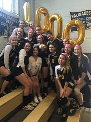 The Cresskill girls volleyball team celebrates after Jenna Alvarez (center, with gold ball) recorded her 1,000th career assist on Oct. 6, 2017 at Palisades Park.