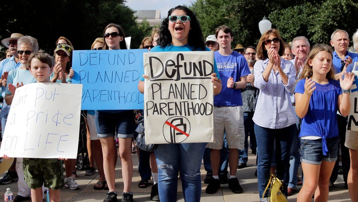 Anti-abortion activists rally on the steps of the Texas