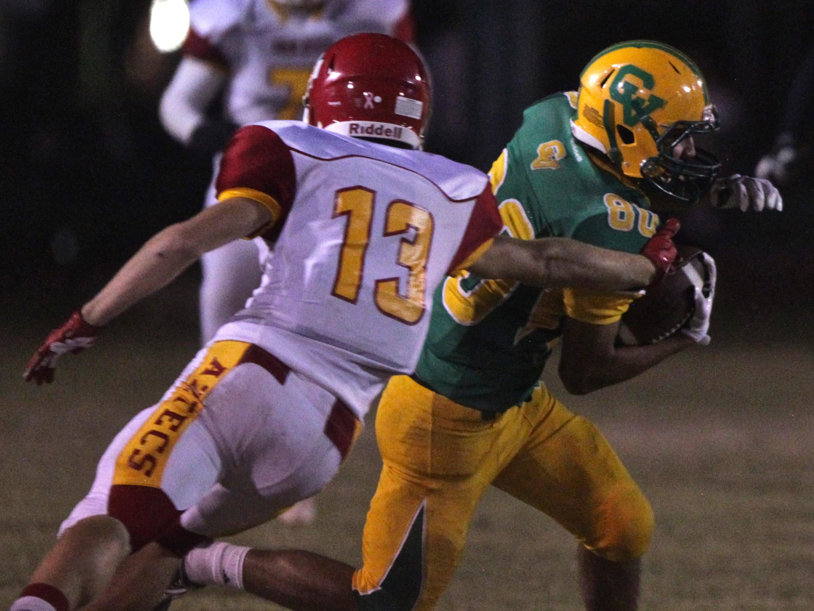 Palm Desert's Brooks Stephenson (13) attempts to stop Arabs' Jacob Salazar (80) during an away game on Friday.