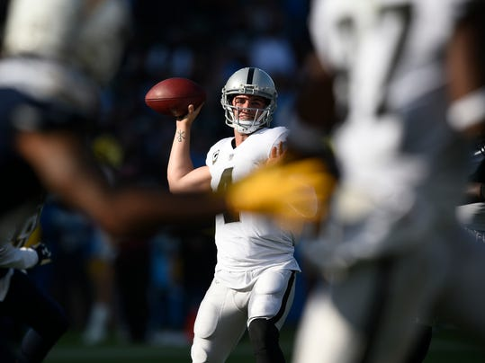 Oakland Raiders quarterback Derek Carr throws a pass during the first half of the team's NFL football game against the Los Angeles Chargers, Sunday, Dec. 31, 2017, in Carson, Calif. (AP Photo/Kelvin Kuo)