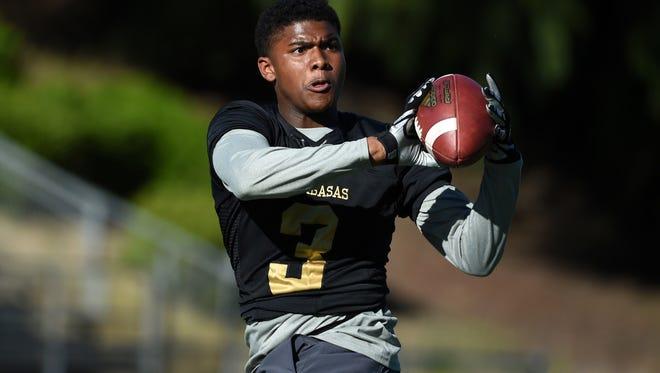 Keyshawn Johnson Jr. joins several former Calabasas (Calif.) High School teammates in Tucson.