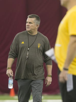 ASU head coach Todd Graham looks over the team during night practice at ASU's Dickey Dome in Tempe, AZ on August 10, 2015.