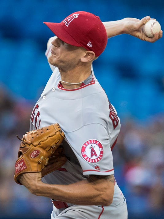 Los Angeles Angels starting pitcher Parker Bridwell throws against the Toronto Blue Jays during the first inning of a baseball game in Toronto, Friday, July 28, 2017. (Fred Thornhill/The Canadian Press via AP)