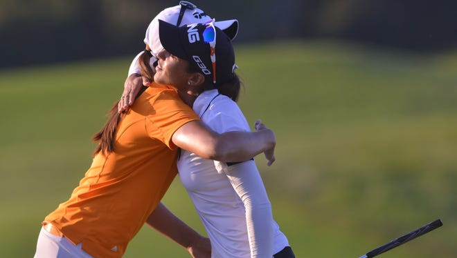 Yokohama Tire LPGA Classic co-leaders Mi Jung Hur, left, and Paula Reto hug after finishing late during the third round on the Senator Course of Robert Trent Jones Golf Trail at Capitol Hill on Saturday in Prattville.