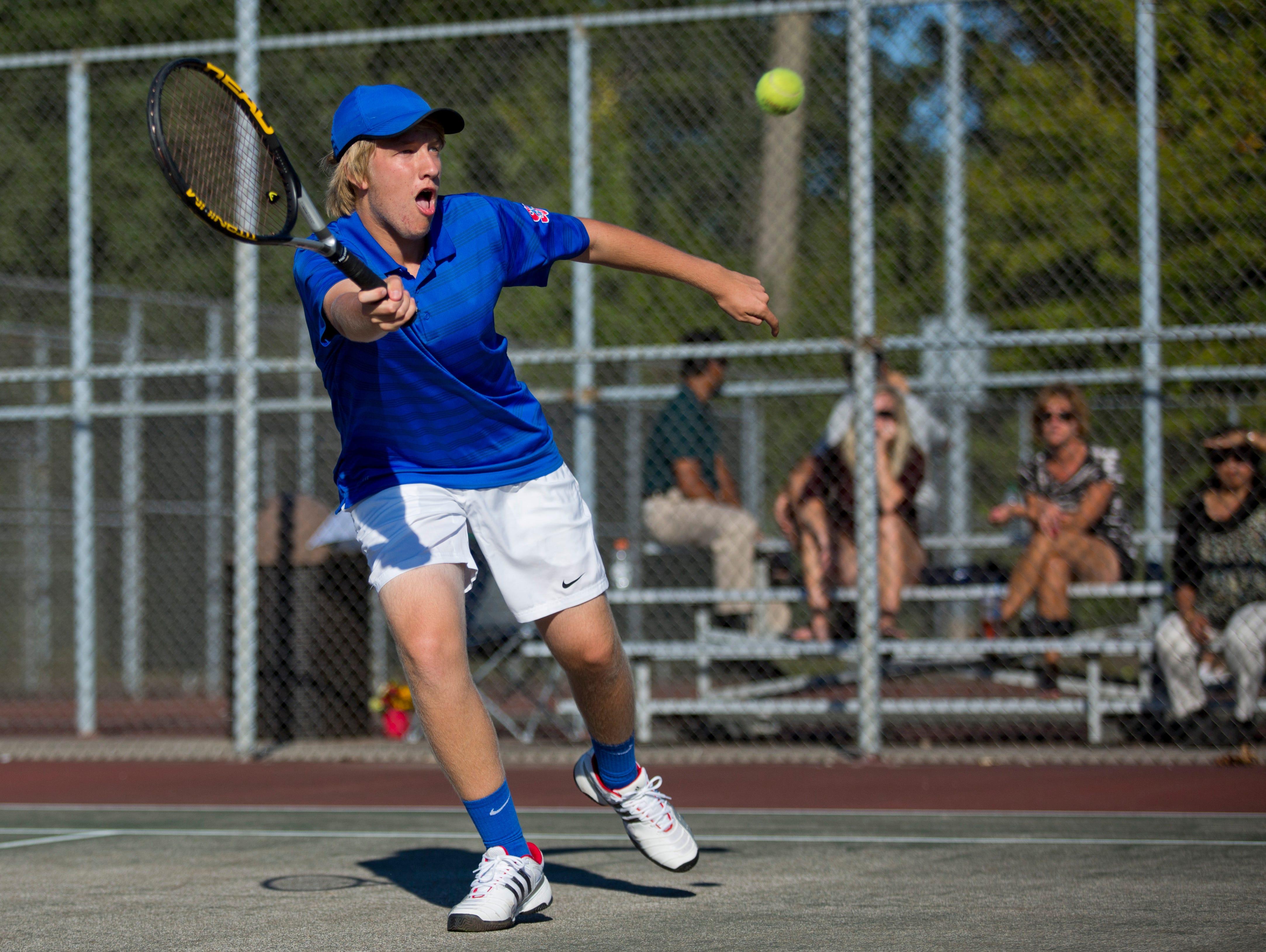 St. Clair senior Matt Tetreau returns the ball during a tennis match Wednesday, September 23, 2015 at Port Huron Northern High School.