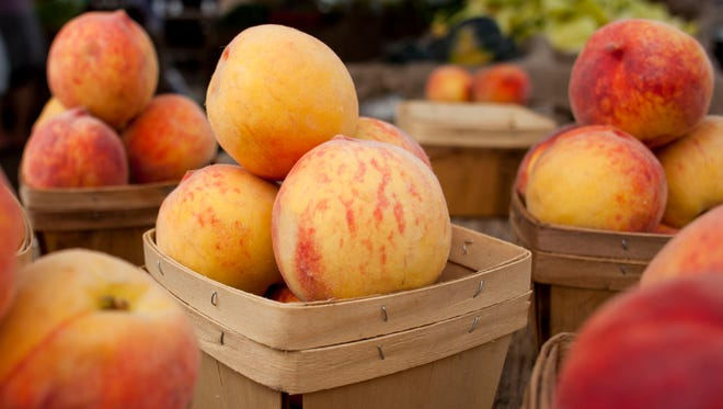 Baskets of peaches are displayed for sale Tuesday at the Vantage Point farmers market in Port Huron.