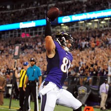 Sep 11, 2014; Baltimore, MD, USA; Baltimore Ravens tight end Owen Daniels (81) celebrates after scoring a touchdown in the first quarter against the Pittsburgh Steelers at M&T Bank Stadium. Mandatory Credit: Evan Habeeb-USA TODAY Sports