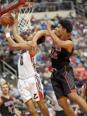 The Cedars' Shaquell Ortiz goes in for a layup during