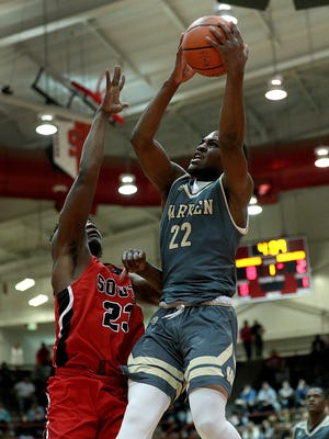 Warren Central Warriors David Bell (22) drives on Terre Haute South Braves DeÕAvion Washington (23) in the first half of their regional championship game at Southport High School on Saturday, March 10, 2018.