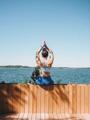 SuperShe promotes healthy living with activities such as yoga on the female-only island off Finland.