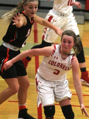 Laci Reinhart of Dixie Heights tries to get past Brie Crittendon of Ryle.  Ryle at Dixie Heights. Girls basketball. Jan. 6, 2017. Dixie Heights High School. Edgewood KY. Ryle won the game.