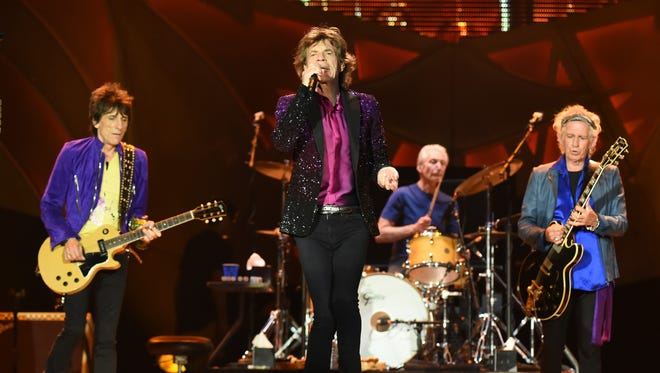 Mick Jagger, center, and his Rolling Stones bandmates opened their 2015 North American tour Sunday in San Diego.