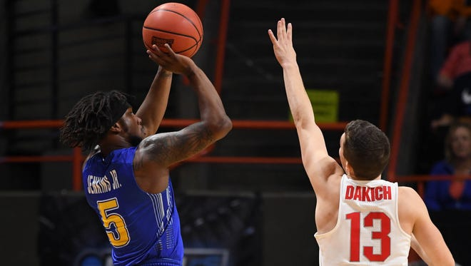 Mar 15, 2018; Boise, ID, USA; South Dakota State Jackrabbits guard David Jenkins Jr. (5) shoots as Ohio State Buckeyes guard Andrew Dakich (13) defends in the first half during the first round of the 2018 NCAA Tournament at Taco Bell Arena. Mandatory Credit: Kyle Terada-USA TODAY Sports