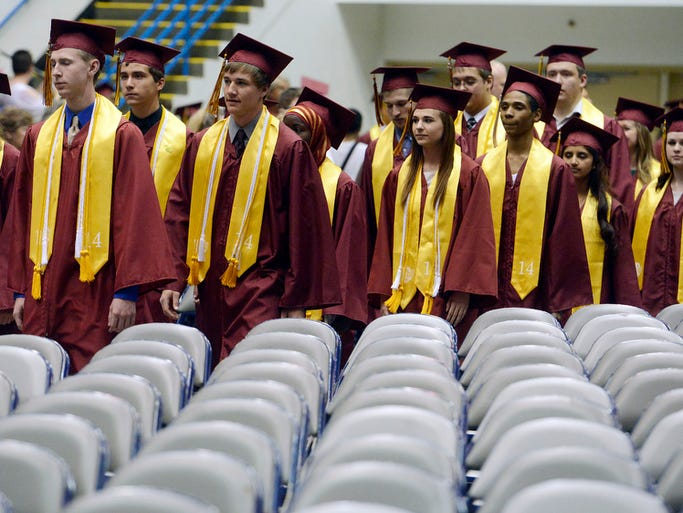 Graduates proceed to their seats Sunday at the Roosevelt High School graduation ceremony at the Sioux Falls Arena, May 18, 2014.