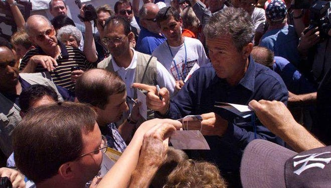 George W. Bush wades through the crowd at the 1999 Iowa Straw Poll, which he won, before going on to win the Iowa caucuses, the Republican nomination and the presidency.