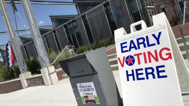 A drop-off box for mail-in ballots stands outside the polls at the Blackstone Heritage Corridor Visitor Center in Worcester on Sunday during early voting hours.