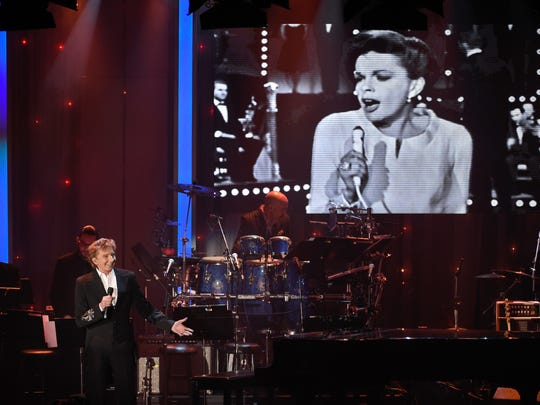 An image of Judy Garland is seen on a video screen behind Barry Manilow at the 2016 Clive Davis Pre-Grammy Gala Feb. 14 in Beverly Hills, Calif.