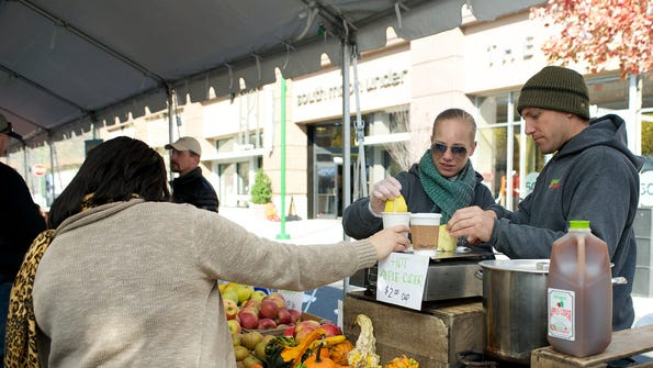 Guests sample hot apple cider at last year's Harvestfest at Ridge Hill.