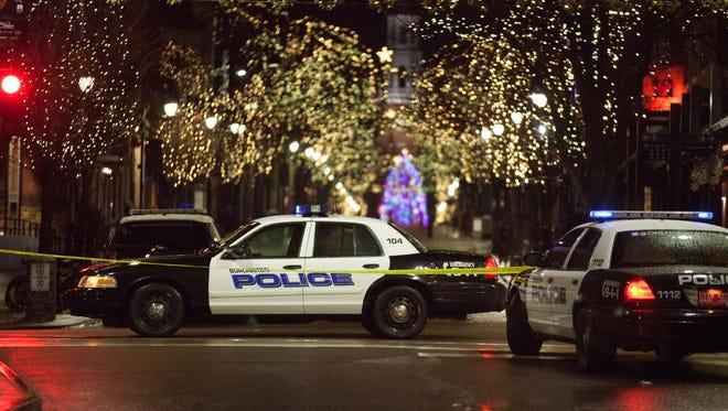 Police cars block lower Church Street in Burlington in December.