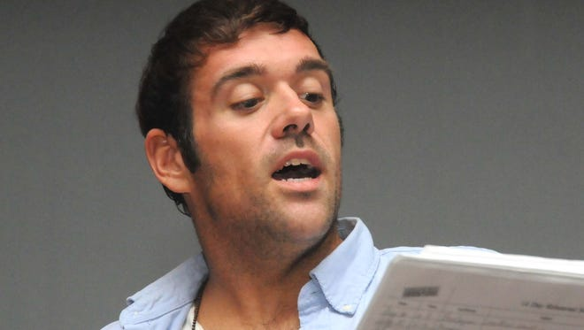 Thomas Guzzi Jr. rehearses for 'Titanic' at Landis Theater in 2010. Guzzi, a teacher at Winslow School in Vineland, was arrested on child-porn charges Friday.