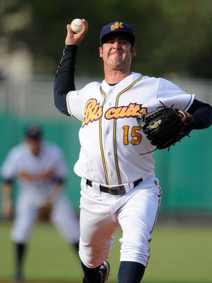 Montgomery Biscuits pitcher Dylan Floro throws against the Jacksonville Suns at Riverwalk Stadium in Montgomery, Ala. on Sunday July 27, 2014.