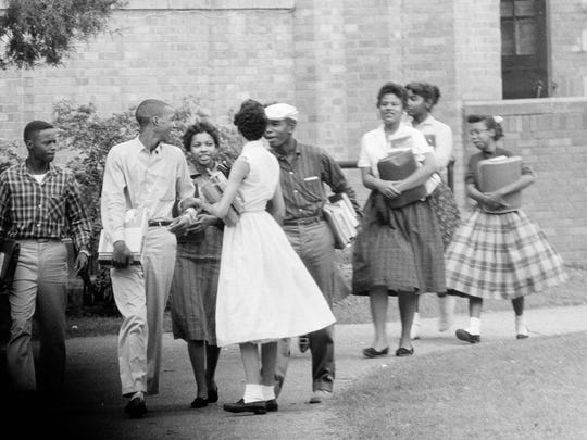 Eight of the Little Rock Nine, black students attending Central High School in Little Rock, Ark., are shown as they walked from school to their waiting Army station wagon, Oct. 2, 1957.