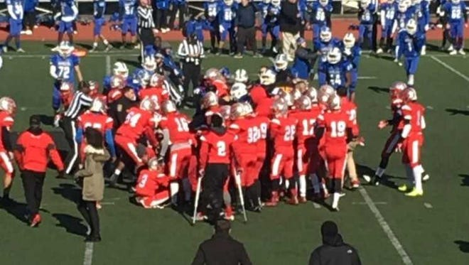 Football players from Carteret and Perth Amboy high schools mix it up on the field during their annual Thanksgiving Day game.