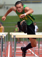 Johnny Quitugua negotiates a hurdle en route to winning the 110-meter hurdles, the first of his two hurdles victories April 8 in the 12th Mike Petty Memorial Meet at Camp Foster on Okinawa.