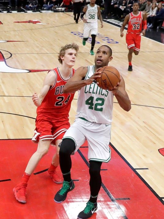 Boston Celtics' Al Horford (42) drives past Chicago Bulls' Lauri Markkanen during the first half of an NBA basketball game Monday, March 5, 2018, in Chicago. (AP Photo/Charles Rex Arbogast)