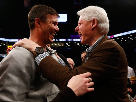 Brooks Koepka and Bill Clinton meet up before the Bucks-Nets game on Feb. 4, 2019 in Brooklyn.